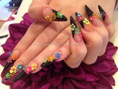 Black sculptured stiletto tips with freehand 3D acrylic flower nail art