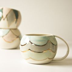 porcelain cups. white pastel and gold ceramic cups. large drinking cup, tea cup, unique coffee cup. scallop pattern, karoArt ceramics