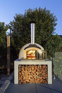 These fire pit ideas and designs will transform your backyard. Check out this list propane fire pit, gas fire pit, fire pit table and lowes fire pit of ways to update your outdoor fire pit ! Find 30 inspiring diy fire pit design ideas in this article. Outdoor Bbq Kitchen, Pizza Oven Outdoor, Outdoor Kitchen Design, Wood Oven Pizza, Brick Oven Outdoor, Outdoor Kitchens, Modern Outdoor Pizza Ovens, Patio Design, Garden Design