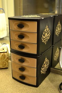Great way to make those ugly plastic drawers match the rest of the bathroom decor