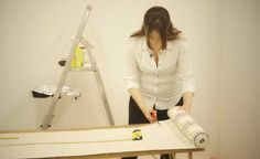 DIY tips: How to wallpaper a wall via Real Homes Magazine
