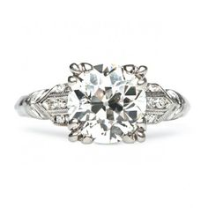 Regents Park is a classic Art Deco engagement ring centering a 2.00ct Old European cut diamond in a triple talon prong setting. Amazing! TrumpetandHorn.com