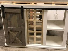 This beautiful mini bar is a custom handcrafted piece of furniture is perfect to display your wine and glasses. When you purchase this mini bar you are truly getting something one of a kind. The piece comes with everything pictured. Standard dimensions are 18 in width and 36 in height.