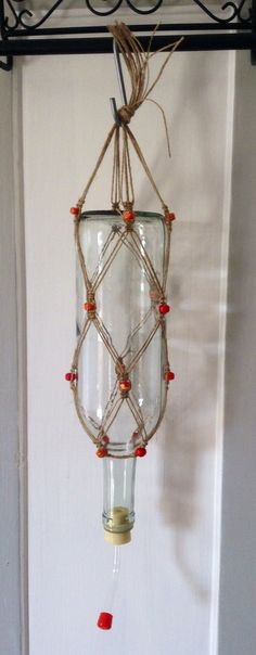 Repurposed Wine Bottle and Macrame Hummingbird by PrettyCoolStuff1, $25.00. Perfect for your garden oasis.