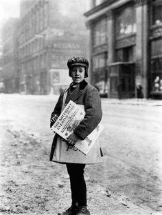 1910. Newspaper Boy. 10-year-old Marshall Knox delivers Saturday Evening Post newspapers on a snowy Main Street in Rochester, New York Photographed by Lewis Wickes Hine on February 10, 1910.