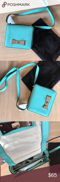 """Mint Kate Spade Bow Clasp Crossbody Purse New with out tag. Flap front with twist closure. Dust bag included.  Dimension: 7"""" x 2.25"""" x 5.75"""" kate spade Bags Crossbody Bags"""