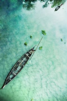 Paradise: Going through crystal clear water in a boat