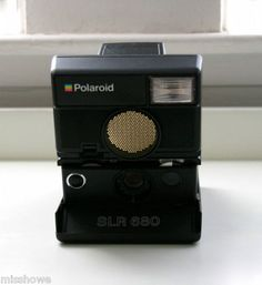 Polaroid SLR 680 Autofocus Land Camera with User Guide