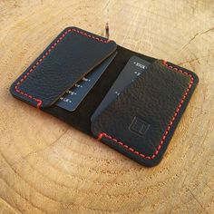 A black and red credit card wallet. Source by recipes thanksgiving Leather Bag Pattern, Sewing Leather, Leather Craft, Credit Card Wallet, Credit Cards, Diy Wallet, Leather Card Wallet, Minimalist Wallet, Leather Projects
