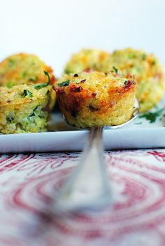 Mini Ham & Cheese Quinoa Cups  2 cups cooked quinoa (about 3/4 cup uncooked)  2 eggs  2 egg whites  1 cup zucchini, shredded  1 cup shredded sharp cheddar cheese  1/2 cup diced ham  1/4 cup parsley, chopped  2 Tablespoons parmesan cheese  2 green onions, sliced  salt & pepper