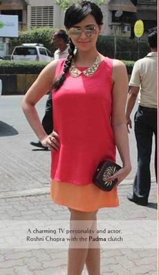 Roshni Chopra- Indian TV personality and actor carries the Rachana Reddy 'Padma' bag   #roshni chopra #rachanareddy #wood #woodenclutch #clutch #bag #fashion #accessory #madeinindia  #padma #lotus #india #bollywood #celeb   Shop here: www.rachanareddy.com