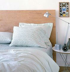 his next headboard couldn't be more unique! A large slab of wood becomes a one-of-a-kind backing for a bed featuring eclectic pillows. Are there other natural or found items that can become your ideal headboard? This image can't help but inspire endless possibilities… [design by Daniel Bodenmiller, from HGTV.com]