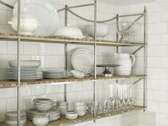 A triple-bayed, polished-nickel pot rack offers plenty of storage without being visually distracting.