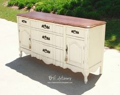 White painted dresser with wood top.