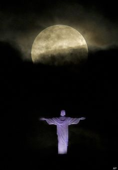 "A ""supermoon"" is seen above the Christ the Redeemer statue in Rio de Janeiro, Sunday, May 6, 2012. A supermoon is the coincidence of a full moon (or a new moon) with the closest approach the moon makes to the Earth. (AP Photo/Victor R. Caivano)"