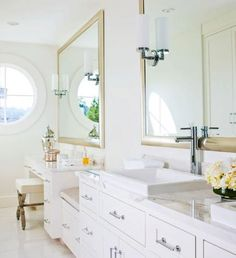 Large mirrors above the bathroom sinks and vanity reflect the light as well as images of the lake outside. - Traditional Home ® / Photo: John Granen / Design: Susan Marinello