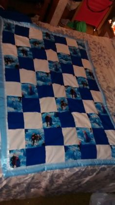 "$100 with free shipping. This quilt is made out of 100% cotton Frozen print and 100% cotton royal blue and cream solid fabric. Back is made out of 100% polyester single side royal blue anti-pill fleece. Inside has Mountain Mist Cotton batting inside. Satin ribbon binding finishes of this amazing quilt.   Quilt measurements are roughly 38"" x 52"".   This quilt is made in a smoke free but cat friendly home.   To purchase this item either leave email address below or check out my Etsy shop at…"
