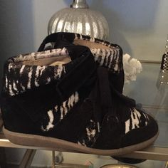 Isabel Marant Blossom Pony Wedge Sneaker Size 9 BLACK/WHITE Athletic Shoes. Get the must-have athletic shoes of this season! These Isabel Marant Blossom Pony Wedge Sneaker Size 9 BLACK/WHITE Athletic Shoes are a top 10 member favorite on Tradesy. Save on yours before they're sold out!