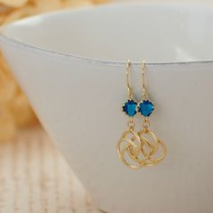 A personal favorite from my Etsy shop https://www.etsy.com/listing/265979915/tiny-blue-glass-rose-dangles-blue-gold