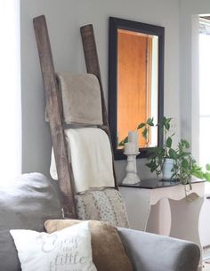 Throw those cute blankets on a rustic old latter and your set to go!