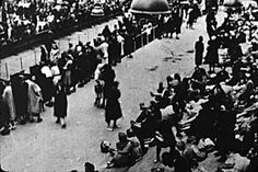 Jewish people assembled inside the Velodrome d'Hiver in Paris, awaiting deportation to Auschwitz