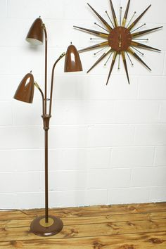 The Vintage Mid Century Modern Floor Lamp With 3 Lights. Ha!  How many clocks do we have like this one?
