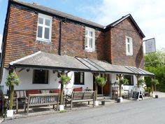 The Hawkley Inn ~ Located in the stunning, picturesque village of Hawkley - some three and a half miles north of Petersfield, the inn shines brightly in an area of outstanding natural beauty, attracting walkers, cyclists, horse riders, back packers and outdoorsy types in general drawn to the breathtaking views of its South Downs National Park location, its selection of seven real ales and its fresh, locally-sourced seasonal menu.