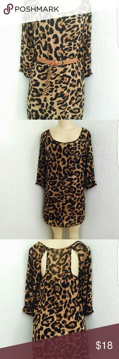 Leopard print tunic Fits right above knee. Includes belt. In excellent condition. Wear as a dress or with jeans and legging. So many ways to style. Just take a pick!! Dresses
