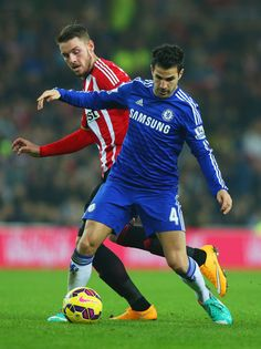Cesc Fabregas of Chelsea holds off Connor Wickham of Sunderland during the Barclays Premier League match between Sunderland and Chelsea at Stadium of Light on November 29, 2014 in Sunderland, England.