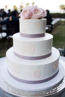 White Wedding Cake with Purple Ribbons and Pink Roses