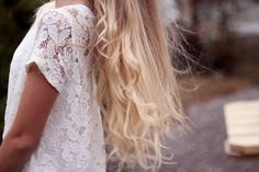 Love lace shirts and semi-curled hair.