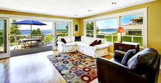 Living room with bay views and large wraparound deck.