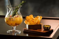 The Punch Room mixlogist and craftsman at The Ritz-Carlton, Charlotte recommends the Za'atar Potato Chips paired with our Perfect Pear Punch.