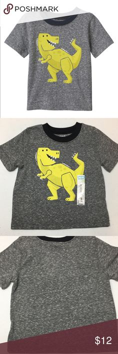 Jumping Beans Boys Dino Graphic Tee New Give your dino dude a supercool look with this boys' Jumping Beans dinosaur graphic tee. In gray.  PRODUCT FEATURES 	•	Contrasting solid crewneck 	•	Short sleeves 	•	Nep details  FABRIC & CARE 	•	Cotton, polyester 	•	Machine wash 	•	Imported  Brand new with attached tags. Jumping Beans Shirts & Tops Tees - Short Sleeve
