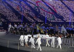 Opening Ceremonies: The Olympic flag is carried during the opening ceremony of the London 2012 Olympic Games