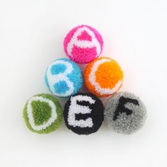 Learn how to make these alphabet pompoms with step-by-step guide!