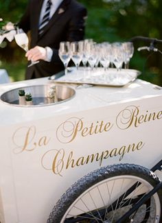 "Why save the champagne toast for the reception? Have a ""we did it!"" toast with all your guests to close out the ceremony. I mean, have you ever seen something more adorable than this champagne pushcart?! #ceremonyexit"
