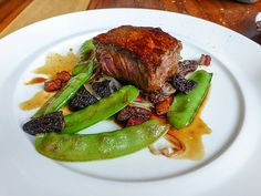 Sirloin with mushroom, bacon and snow peas at Restaurant Toque! Montreal by Jeff Houck, via Flickr