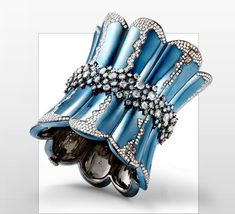 Titanium Cuff  Titanium Cuff in Rose Cut Diamonds and Round Diamond Pave.