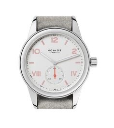 @nomosglashuette Club Campus (Ref. 708) - this 36 mm watch was produced for slimmer wrists than its counterparts. The dial is white silver-plated, and its hour markers are each outlined in an eye-catching red. The watch's strap is beige velour leather.  More @ http://www.watchtime.com/wristwatch-industry-news/watches/nomos-launches-new-club-campus-series-at-baselworld-2017/ #nomosglashuette #watchtime #germanwatches #Baselworld2017