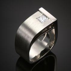 Ultra-modern, burnished platinum band, featuring a princess cut diamond. Wearable art.