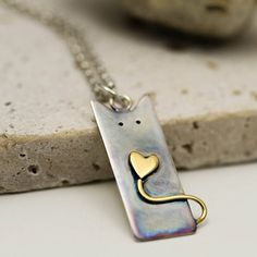 Sterling Silver Cat Necklace with a 24K Gold Plated Heart Tail
