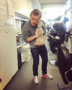 Alfie Allen on set of Predator, with a rescue dog (it is Olivia Munn's)
