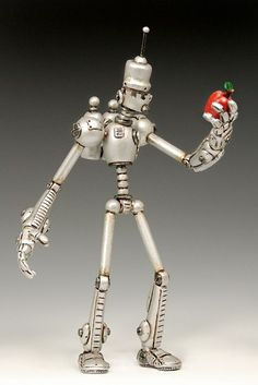 """""""Adam"""", polymer clay, 18.5″ tall - by  Kevin Reaves in his  Automated Humanity robot collection."""