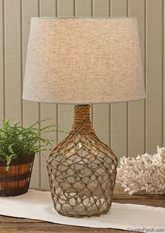Sea Bottle Jug Lamp with Shade, by Park Designs. This nautical inspired sea bottle jug lamp features a jute fishing net overlay. Measures x 9 inches. Use with up to a 100 watt bulb (not included). Wine Bottle Crafts, Bottle Art, Beach House Decor, Diy Home Decor, Bottle Lights, Jute, Table Lamp, Decoration, Glass