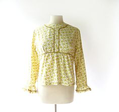 1960s Buttercup print blouse with rick rack trim and ruffle cuffs