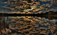Reflection of clouds at sunset wallpaper
