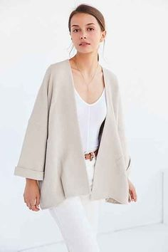 Textured-knit kimono jacket for a modern-boho finish to your outfit every day by Ecote. In an open, oversized silhouette that tapers out to the bottom with cuffed long-sleeves, dropped arms + slanted pouch pockets at the sides.