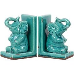 """Set of two weathered elephant bookends with a crackle finish. Product: Set of 2 bookendsConstruction Material: StonewareColor: TurquoiseDimensions: 8.26"""" H x 5.51"""" W x 3.94"""" D each"""