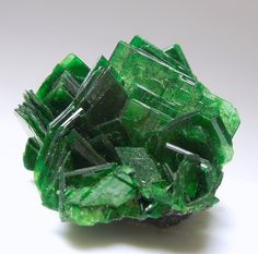 Torbernite. Chemical formula:  Cu(UO2)2(PO4)2·12 H2O.  A radioactive copper uranyl phosphate mineral.